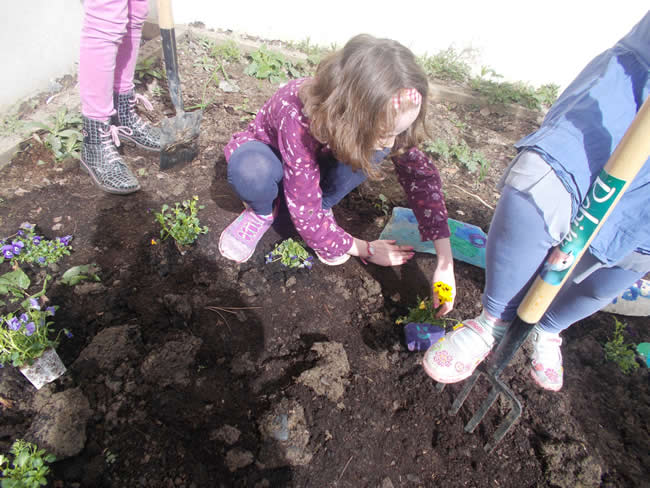 Afterschool children gardening at Park Academy Childcare